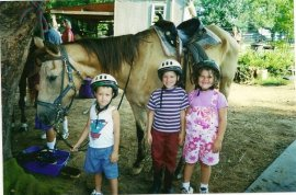 at a summer equine camp for kids with behavior needs in 2001 where we both volunteered so the older kids could get some therapy and socialization.